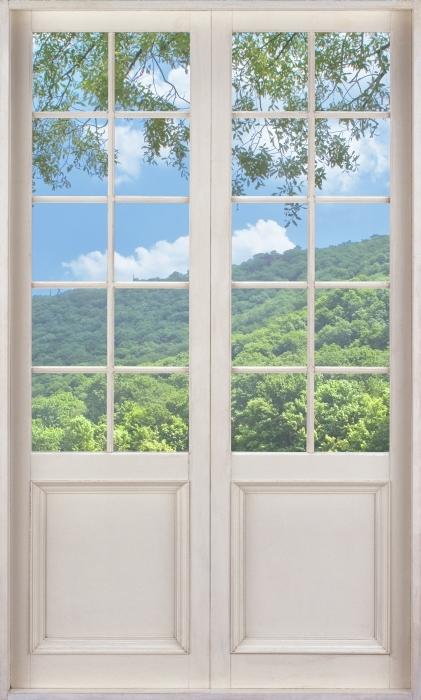 Fototapeta winylowa Białe drzwi - Rzeka - Widok przez drzwi