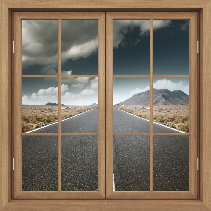 Fototapeta winylowa Okno brązowe zamknięte - Droga przez pustynię. - Widok przez okno