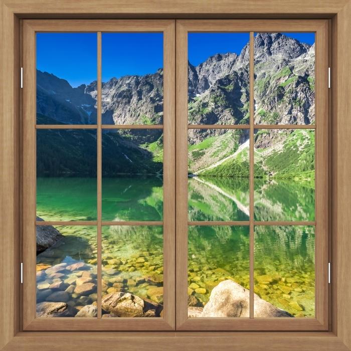 Fototapeta winylowa Okno brązowe zamknięte - Jezioro w górach - Widok przez okno