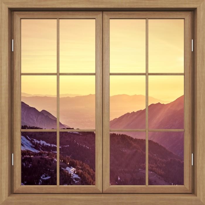 Vinyl-Fototapete Brown Fenster geschlossen - Sonnenuntergang in den Bergen - Blick durch das Fenster