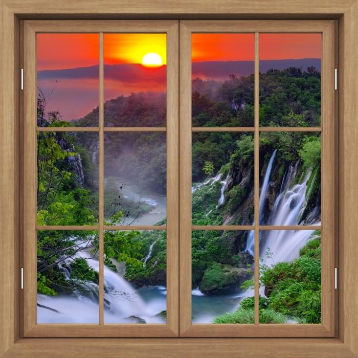Fototapeta winylowa Okno brązowe zamknięte - Wschód słońca. Chorwacja. - Widok przez okno