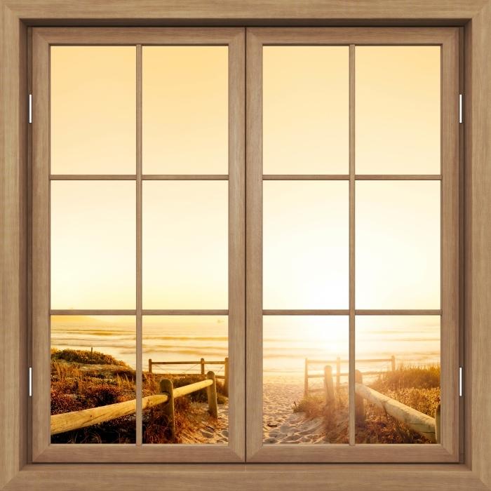 Fototapeta winylowa Okno brązowe zamknięte - Zachód słońca nad oceanem. - Widok przez okno