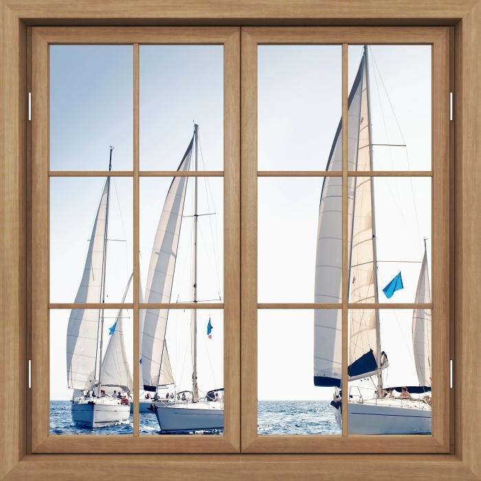 Fototapeta winylowa Okno brązowe zamknięte - Jachty z białymi żaglami - Widok przez okno