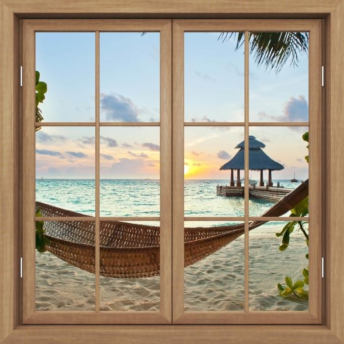Vinyl-Fototapete Brown Fenster geschlossen - Hammock und Sonne - Blick durch das Fenster