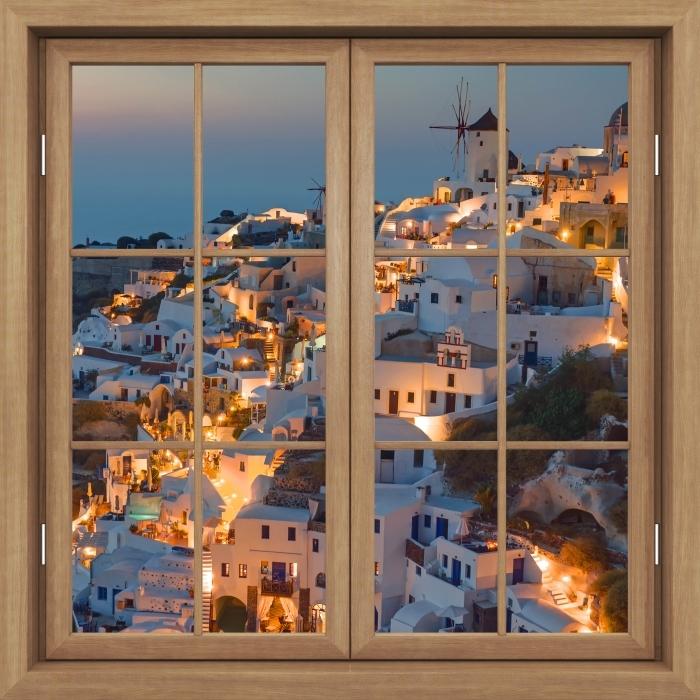 Plakat Okno brązowe zamknięte - Piękny zachód słońca w Oia - Widok przez okno