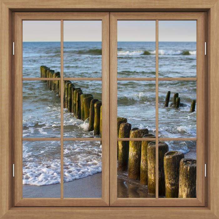 Fototapeta winylowa Okno brązowe zamknięte - Zachód słońca nad Bałtykiem - Widok przez okno