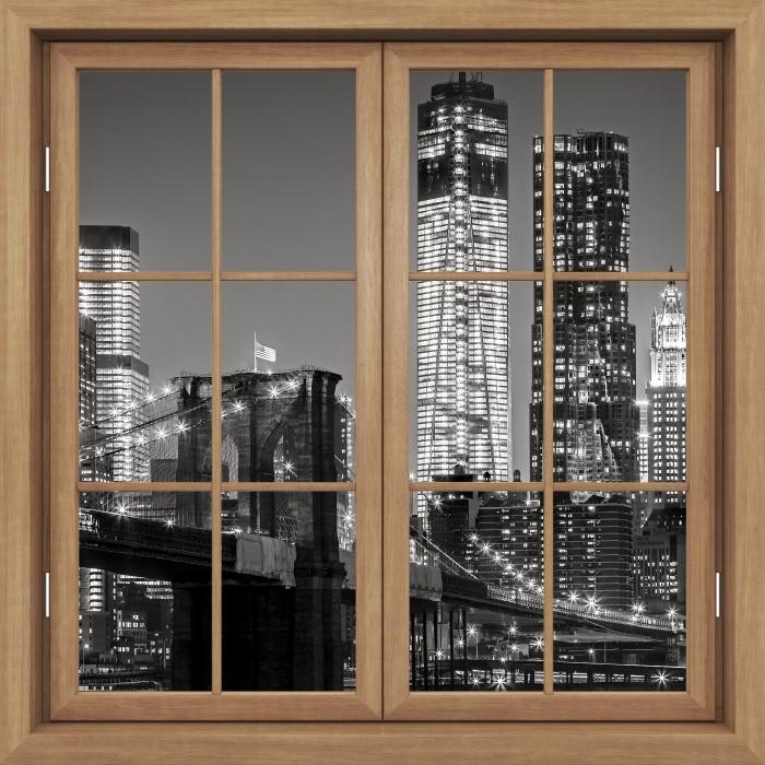 Fototapeta winylowa Okno brązowe zamknięte - Nowy Jork nocą. Brooklyn Bridge. - Widok przez okno