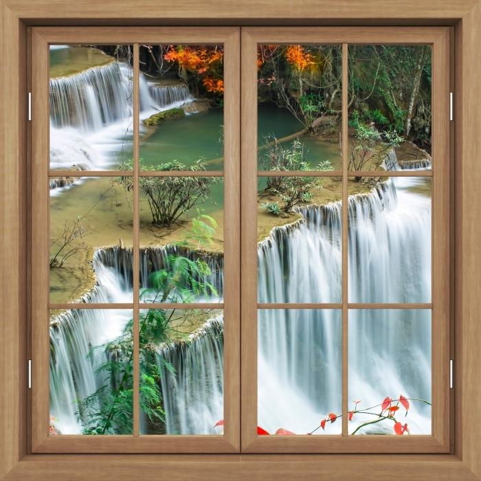 Fototapeta winylowa Okno brązowe zamknięte - Wodospad w lesie tropikalnym - Widok przez okno
