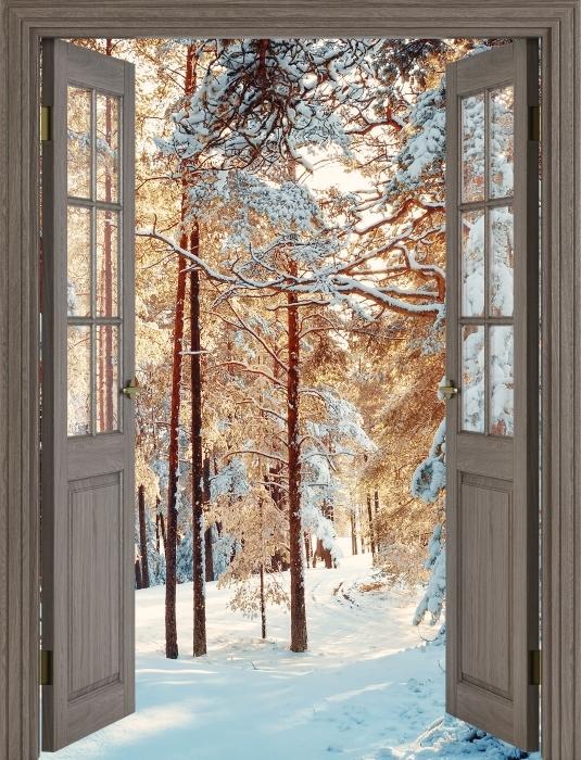 Fototapeta winylowa Brązowe drzwi - Sosny pokryte śniegiem - Widok przez drzwi