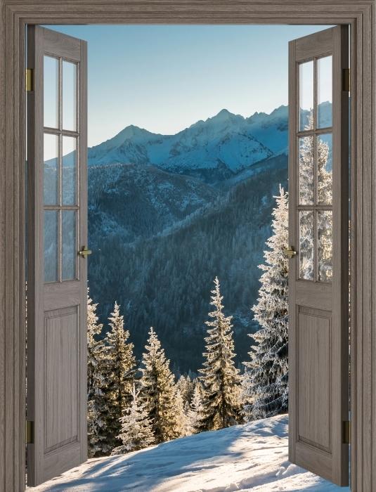 Papier peint vinyle Brown porte - Tatry - La vue à travers la porte