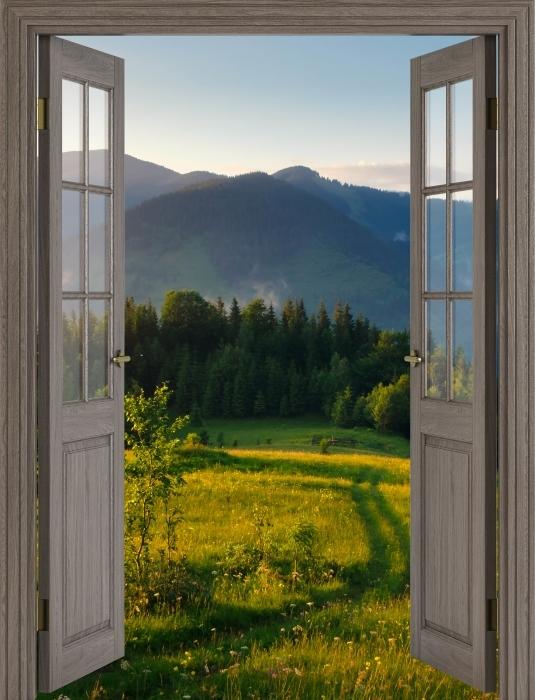 Vinyl Fotobehang Bruine deur - Mountain valley - Uitzicht door de deur