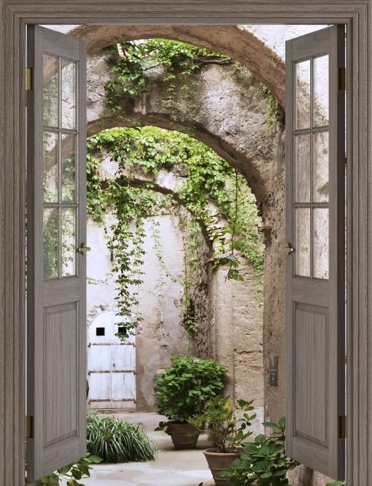 Vinyl Fotobehang Bruine deur - Arcade - Uitzicht door de deur