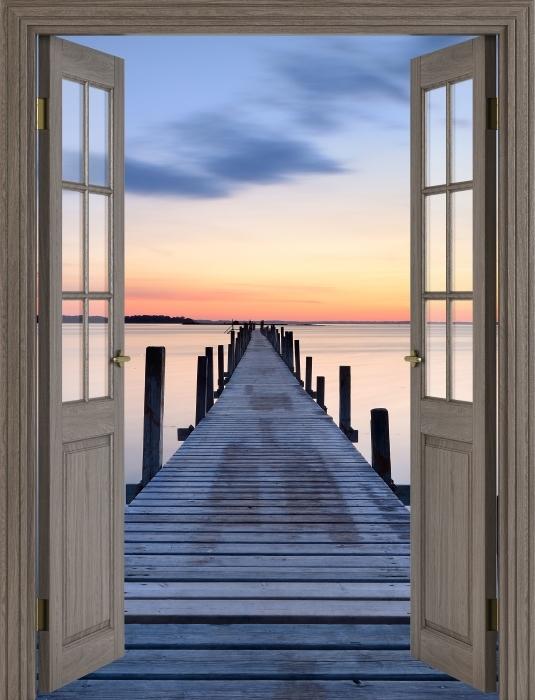 Fototapeta winylowa Brązowe drzwi - Molo - Widok przez drzwi
