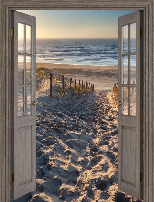 Vinyl Fotobehang Bruine deur - Noordzee - Uitzicht door de deur