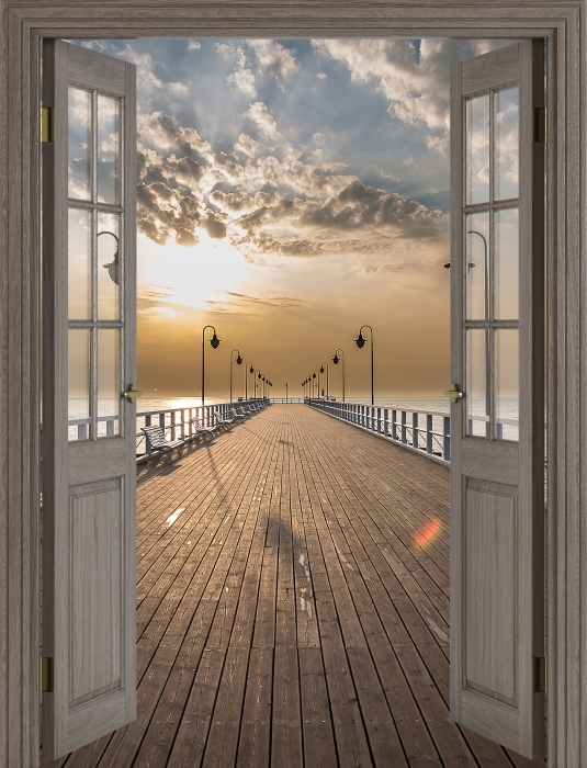 Papier peint vinyle Brown porte - Lever de soleil à la jetée - La vue à travers la porte