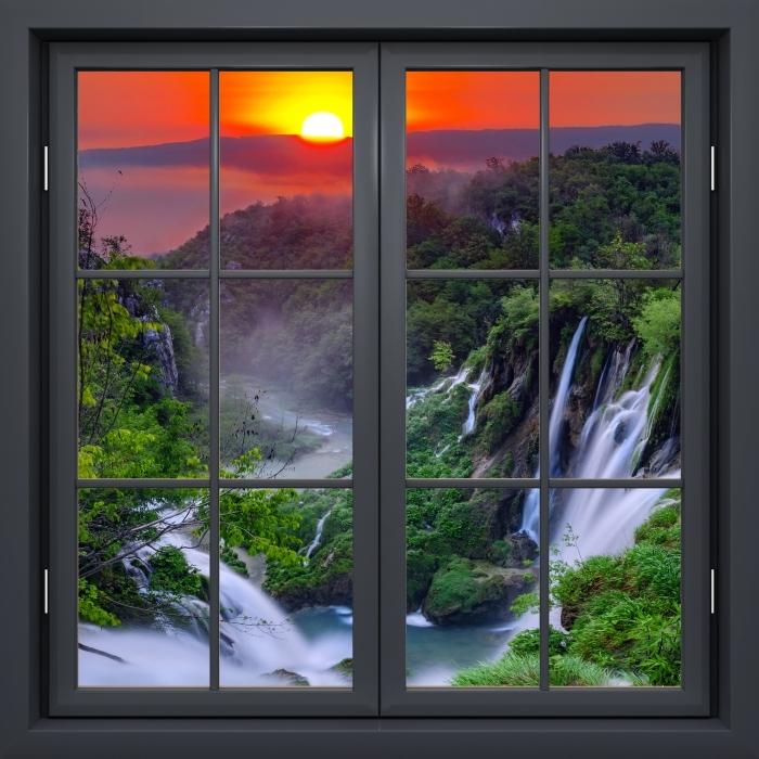 Fototapeta winylowa Okno czarne zamknięte - Wschód słońca. Chorwacja. - Widok przez okno