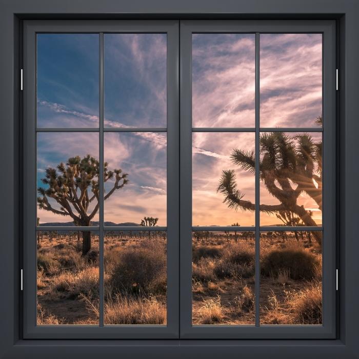 Fototapeta winylowa Okno czarne zamknięte - Zachód słońca. Pustynia. Kalifornia. - Widok przez okno