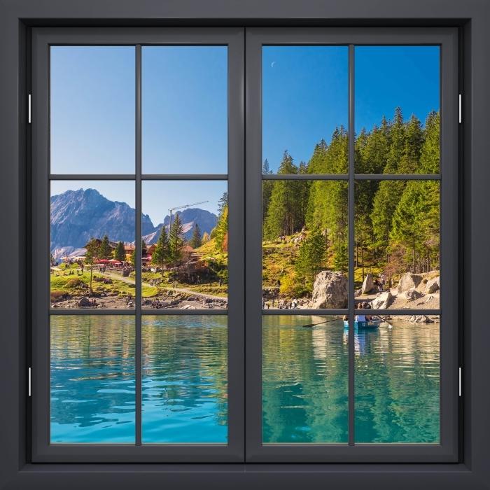 Fototapeta winylowa Okno czarne zamknięte - Błękitne jezioro. Szwajcaria. - Widok przez okno
