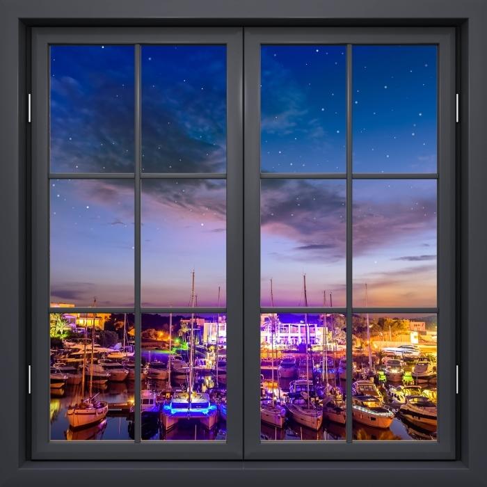 Papier peint vinyle Fenêtre Noire Fermée - Majorque. - La vue à travers la fenêtre