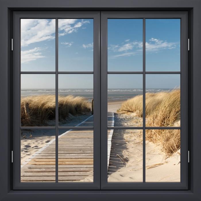 Fototapeta winylowa Okno czarne zamknięte - Nordsee Strand auf Langeoog - Widok przez okno
