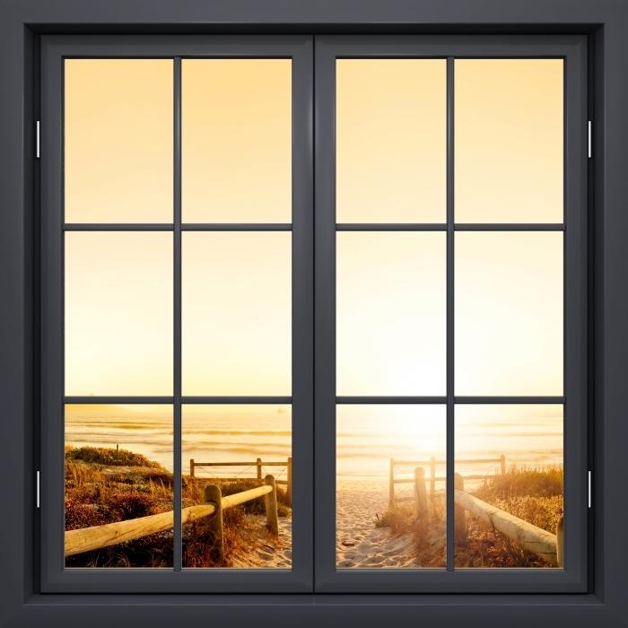 Fototapeta winylowa Okno czarne zamknięte - Zachód słońca nad oceanem. - Widok przez okno