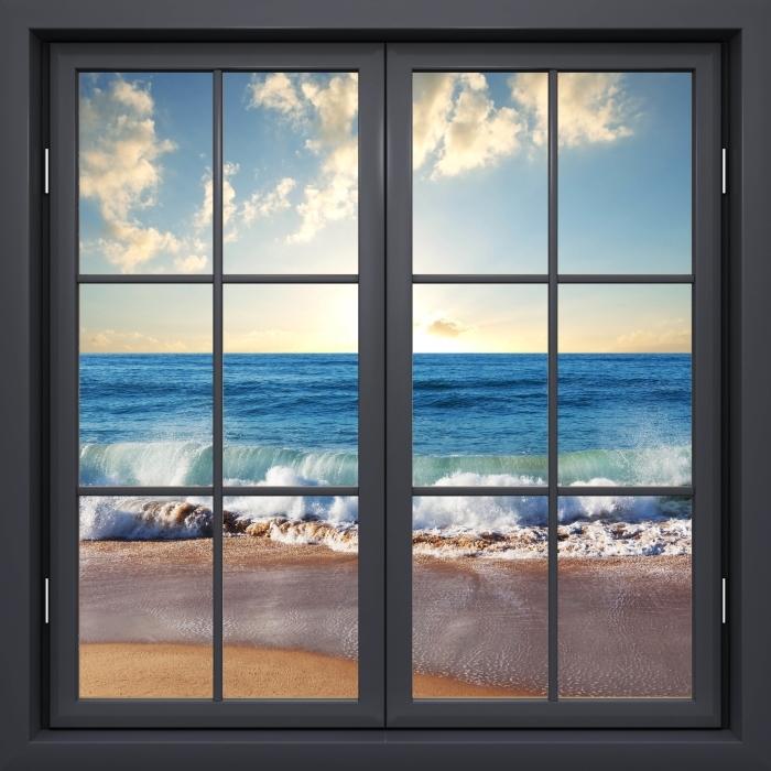 Fototapeta winylowa Okno czarne zamknięte - Morze. Zachód słońca. - Widok przez okno