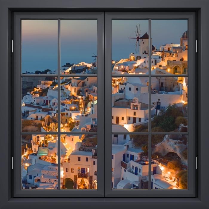 Fototapeta winylowa Okno czarne zamknięte - Piękny zachód słońca w Oia - Widok przez okno