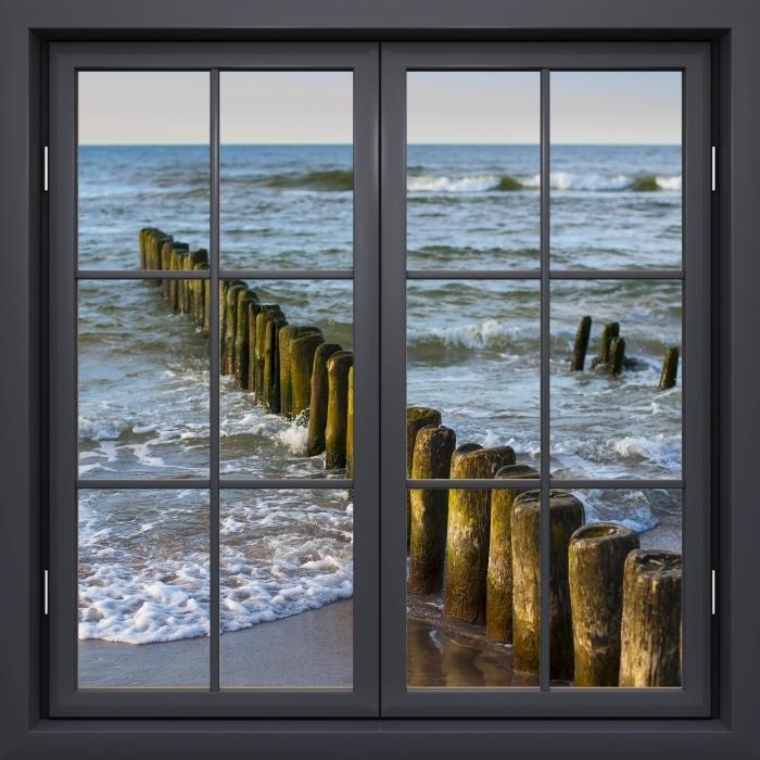 Vinyl-Fototapete Schwarz Fenster geschlossen - Sonnenuntergang an der Ostsee - Blick durch das Fenster