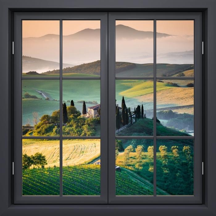 Papier peint vinyle Fenêtre Noire Fermée - Toscane - La vue à travers la fenêtre