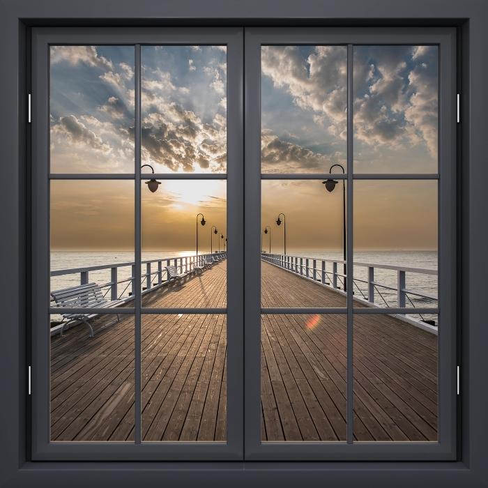 Fototapeta winylowa Okno czarne zamknięte - Wschód słońca na molo - Widok przez okno