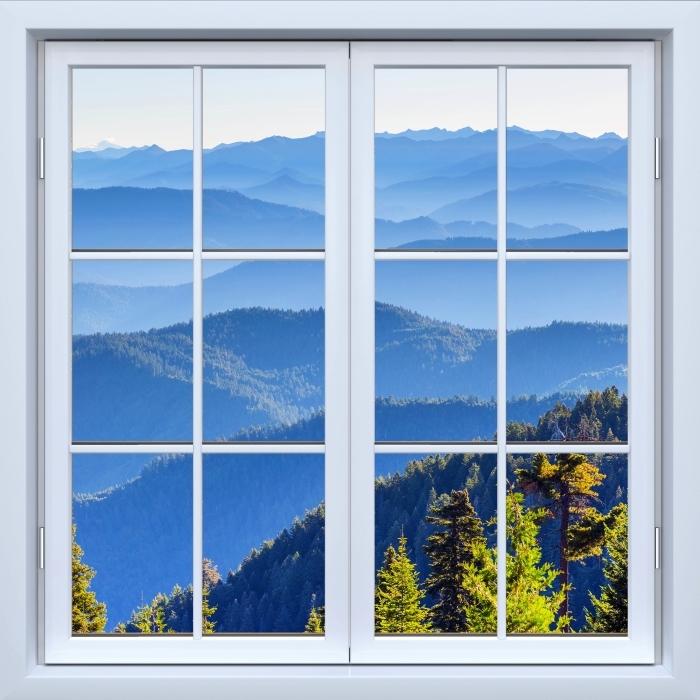 Fototapeta winylowa Okno białe zamknięte - Góry - Widok przez okno