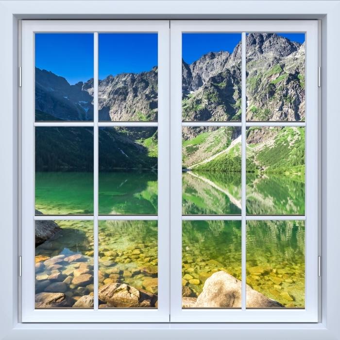 Fototapeta winylowa Okno białe zamknięte - Jezioro w górach - Widok przez okno