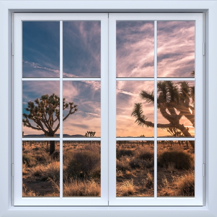 Fototapeta winylowa Okno białe zamknięte - Zachód słońca. Pustynia. Kalifornia. - Widok przez okno