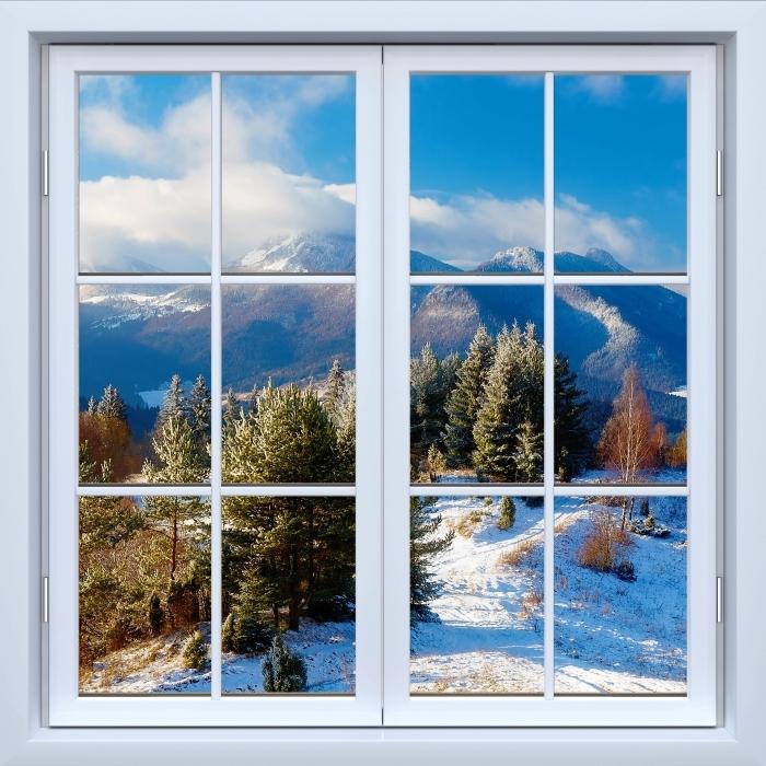 Papier peint vinyle Blanc fenêtre fermée - Paysage enneigé - La vue à travers la fenêtre