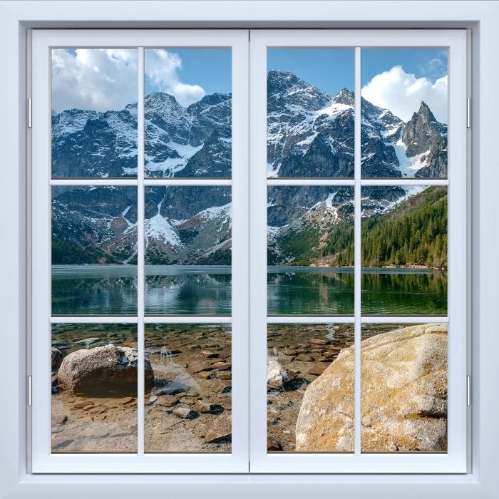 Papier peint vinyle Blanc fenêtre fermée - Sea Eye. Montagnes Tatra. Pologne. - La vue à travers la fenêtre