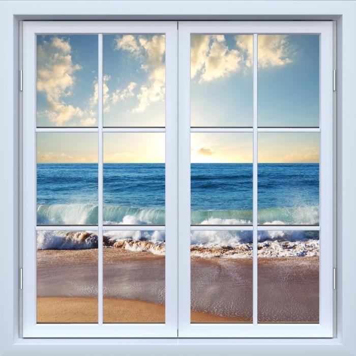 Fototapeta winylowa Okno białe zamknięte - Morze. Zachód słońca. - Widok przez okno