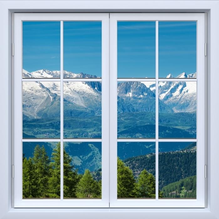 Fototapeta winylowa Okno białe zamknięte - Panorama wysokich górach - Widok przez okno
