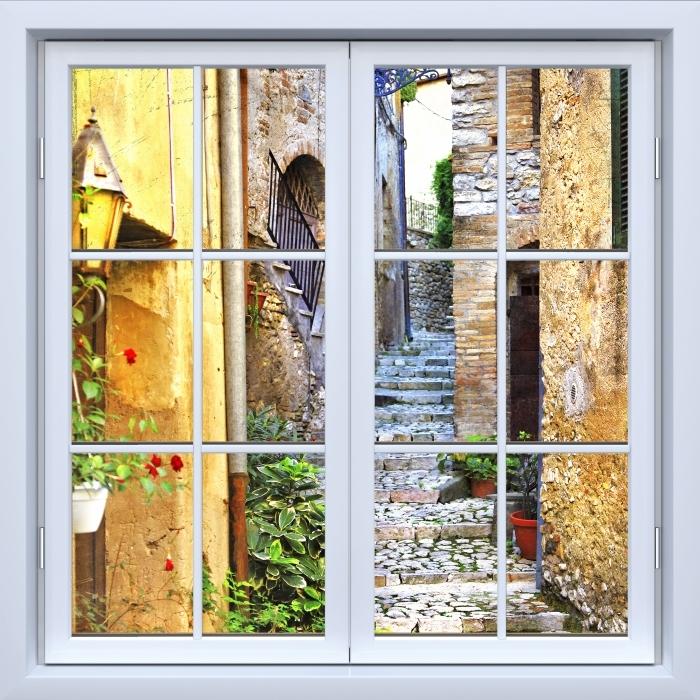 Fototapeta winylowa Okno białe zamknięte - Urocze stare uliczki - Widok przez okno