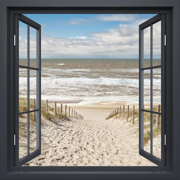 Fototapeta winylowa Okno czarne otwarte - Piasek na plaży w słoneczny dzień - Widok przez okno