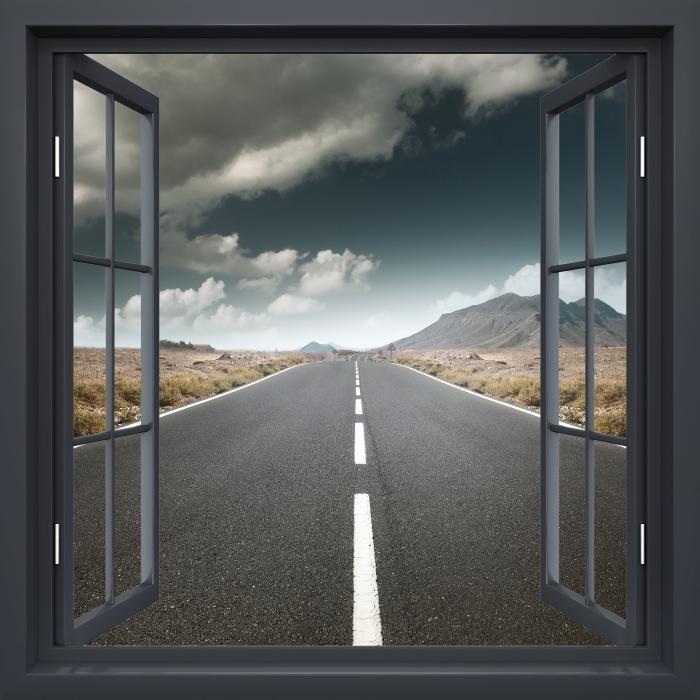 Vinyl Fotobehang Black raam open - Weg door de woestijn. - Uitzicht door het raam