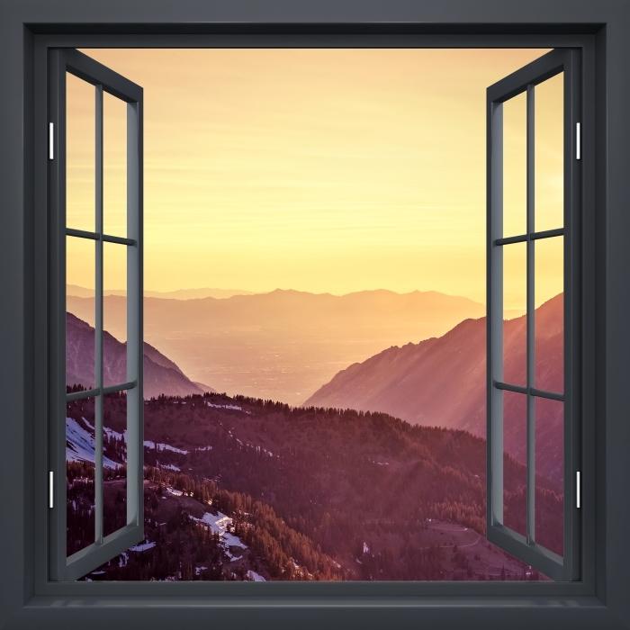 Vinyl Fotobehang Black raam open - Zonsondergang in de bergen - Uitzicht door het raam
