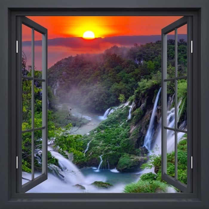Fototapeta winylowa Okno czarne otwarte - Wschód słońca. Chorwacja. - Widok przez okno