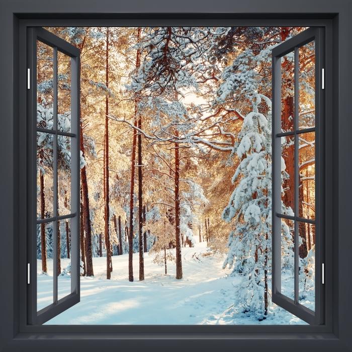 Fototapeta winylowa Okno czarne otwarte - Sosny pokryte śniegiem - Widok przez okno