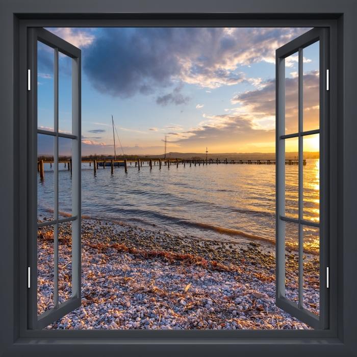 Papier peint vinyle Fenêtre Noire Ouvert - Mara - La vue à travers la fenêtre