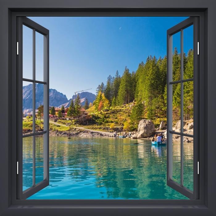Fototapeta winylowa Okno czarne otwarte - Błękitne jezioro. Szwajcaria. - Widok przez okno