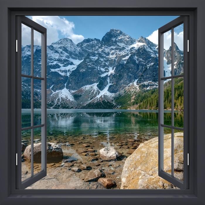 Papier peint vinyle Fenêtre Noire Ouverte - Sea Eye. Montagnes Tatra. Pologne. - La vue à travers la fenêtre