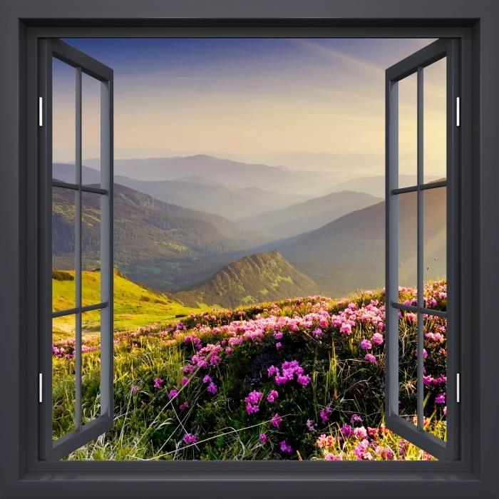 Fototapeta winylowa Okno czarne otwarte - Górski krajobraz - Widok przez okno
