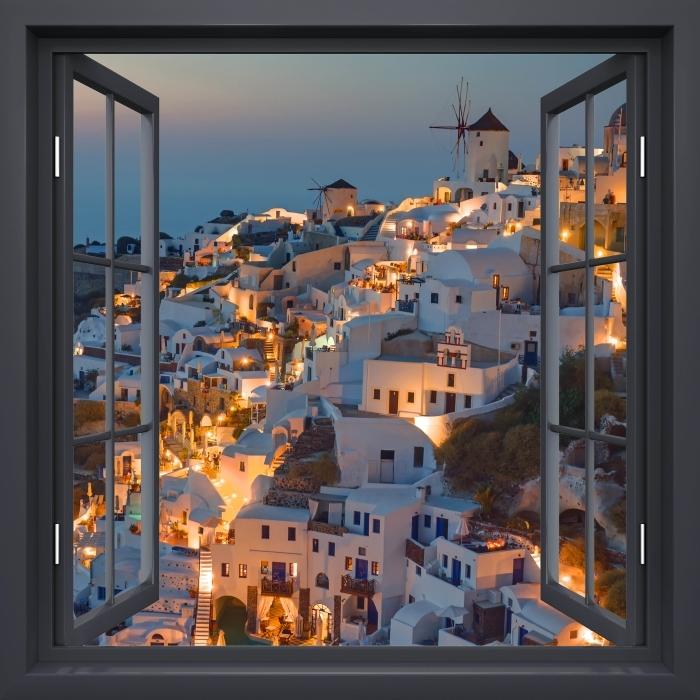 Papier peint vinyle Noir A Ouvert La Fenêtre - Magnifique Coucher De Soleil À Oia - La vue à travers la fenêtre