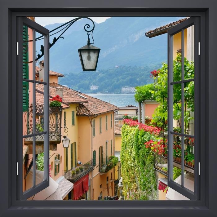 Fototapeta zmywalna Okno czarne otwarte - Malownicze miasteczko we Włoszech - Widok przez okno