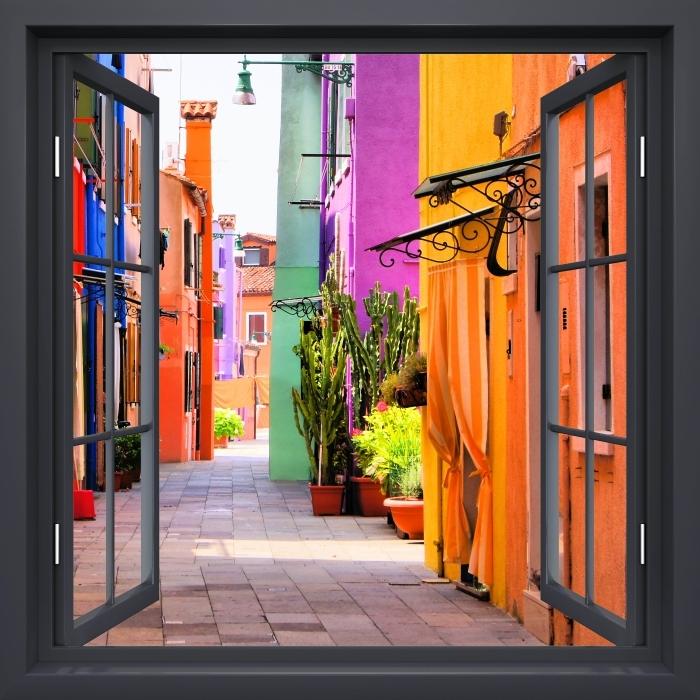 Papier peint vinyle Fenêtre Noire Ouverte - Rue Colorée À Burano. Italie. - La vue à travers la fenêtre